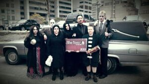 2014 Oct 25 - Bony Fiddle krewe as the Addams Family pose just prior to beginning the Toronto Zombie Walk Halloween Parade